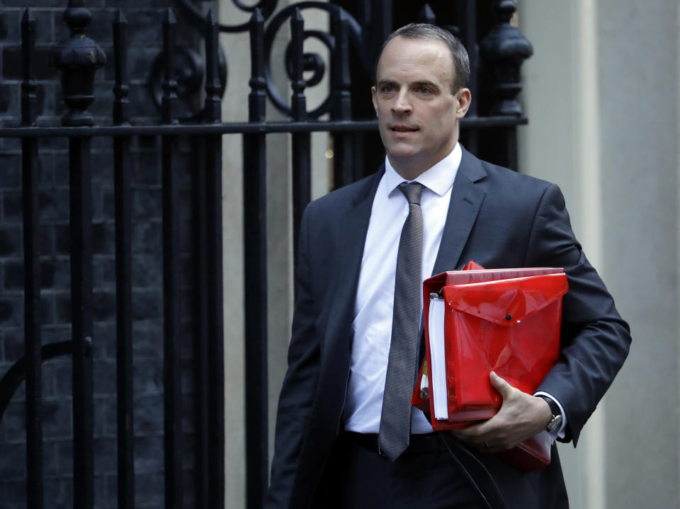 Britain's Secretary of State for Exiting the European Union Dominic Raab leaves Downing Street to attend Prime Minister's questions in London, Wednesday, Nov. 14, 2018. British Prime Minister Theresa May will try to persuade her divided Cabinet on Wednesday that they have a choice between backing a draft Brexit deal with the European Union or plunging the U.K. into political and economic uncertainty. (AP Photo/Matt Dunham)