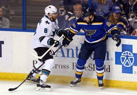 May 23, 2016; St. Louis, MO, USA; San Jose Sharks center Joe Pavelski (8) checks St. Louis Blues center Paul Stastny (26) in the first period in game five of the Western Conference Final of the 2016 Stanley Cup Playoffs at Scottrade Center. Mandatory Credit: Aaron Doster-USA TODAY Sports