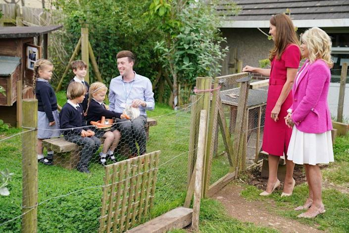 """<p>They brought the carrots to students in the school's Reception Class, who fed them to the rabbit. The Duchess and First Lady also heard a bit about the Reception Class, which, according to a statement, has a """"bespoke Early Years Foundation Stage (EYFS) curriculum, which uses child-led teaching to help its pupils to develop as independent, confident and successful learners.""""<br></p>"""