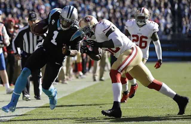 San Francisco 49ers inside linebacker Patrick Willis (52) hits Carolina Panthers quarterback Cam Newton (1) during the first half of a divisional playoff NFL football game, Sunday, Jan. 12, 2014, in Charlotte, N.C. (AP Photo/Gerry Broome)