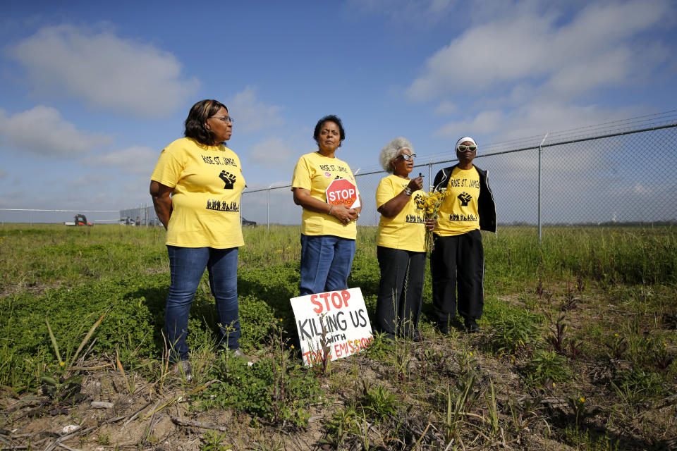 FILE - In this March 11, 2020, file photo, Myrtle Felton, from left, Sharon Lavigne, Gail LeBoeuf and Rita Cooper, members of RISE St. James, conduct a live stream video on property owned by Formosa in St. James Parish, La. The Army Corps of Engineers has suspended its permit for the Chinese conglomerate's $9.4 billion plastics complex on a technicality, but says it may review other aspects of the permit. The Corps says it incorrectly dismissed sites in Ascension Parish when it reviewed whether other potential sites might have fewer environmental effects than the company's chosen location in St. James Parish. (AP Photo/Gerald Herbert, File)