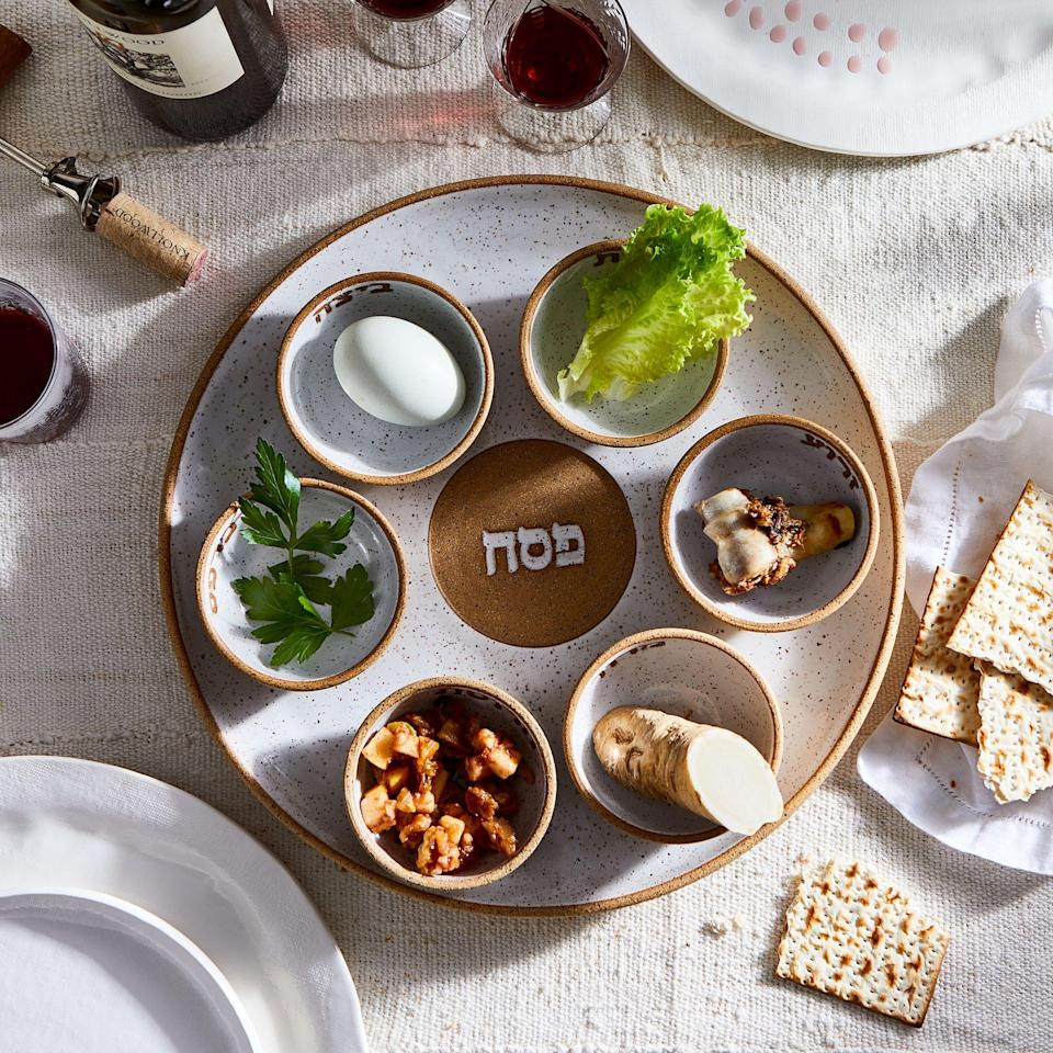 """<p>The first or second night of <a href=""""https://www.marthastewart.com/1513406/passover"""" rel=""""nofollow noopener"""" target=""""_blank"""" data-ylk=""""slk:Passover"""" class=""""link rapid-noclick-resp"""">Passover</a> is the Seder when families get together to begin their observance—including <a href=""""https://www.marthastewart.com/7692462/traditional-seder-plate-passover-modern-versions"""" rel=""""nofollow noopener"""" target=""""_blank"""" data-ylk=""""slk:the Seder plate"""" class=""""link rapid-noclick-resp"""">the Seder plate</a>. """"The Seder plate remains on the table throughout the Passover meal. It serves as a sort of symbolic centerpiece, and is filled with six ingredients or items that serve as metaphors representing various aspects of <a href=""""https://www.marthastewart.com/7753735/first-passover-seder-tips"""" rel=""""nofollow noopener"""" target=""""_blank"""" data-ylk=""""slk:the Passover story"""" class=""""link rapid-noclick-resp"""">the Passover story</a>—which is what the Seder is really all about,"""" says Rebekah Lowin, founder of Jewish-focused lifestyle blog <a href=""""https://rebekahlowin.com/"""" rel=""""nofollow noopener"""" target=""""_blank"""" data-ylk=""""slk:RebekahLowin.com"""" class=""""link rapid-noclick-resp"""">RebekahLowin.com</a>. """"Most families stick to the same six ritual items that have been used for centuries and generations, but some <a href=""""https://www.marthastewart.com/7753878/hosting-virtual-passover-seder-tips"""" rel=""""nofollow noopener"""" target=""""_blank"""" data-ylk=""""slk:newer traditions have emerged"""" class=""""link rapid-noclick-resp"""">newer traditions have emerged</a> over the past few decades, like the inclusion of an orange to symbolize solidarity with women and LGBTQ communities.""""</p> <p>As for the food? """"The Seder plate is comprised with specific <a href=""""https://www.marthastewart.com/274198/passover-recipes"""" rel=""""nofollow noopener"""" target=""""_blank"""" data-ylk=""""slk:foods that are a symbolic aspect"""" class=""""link rapid-noclick-resp"""">foods that are a symbolic aspect</a> of Passover,"""" explains Debi Traub, photographer, stylist, blogger, a"""