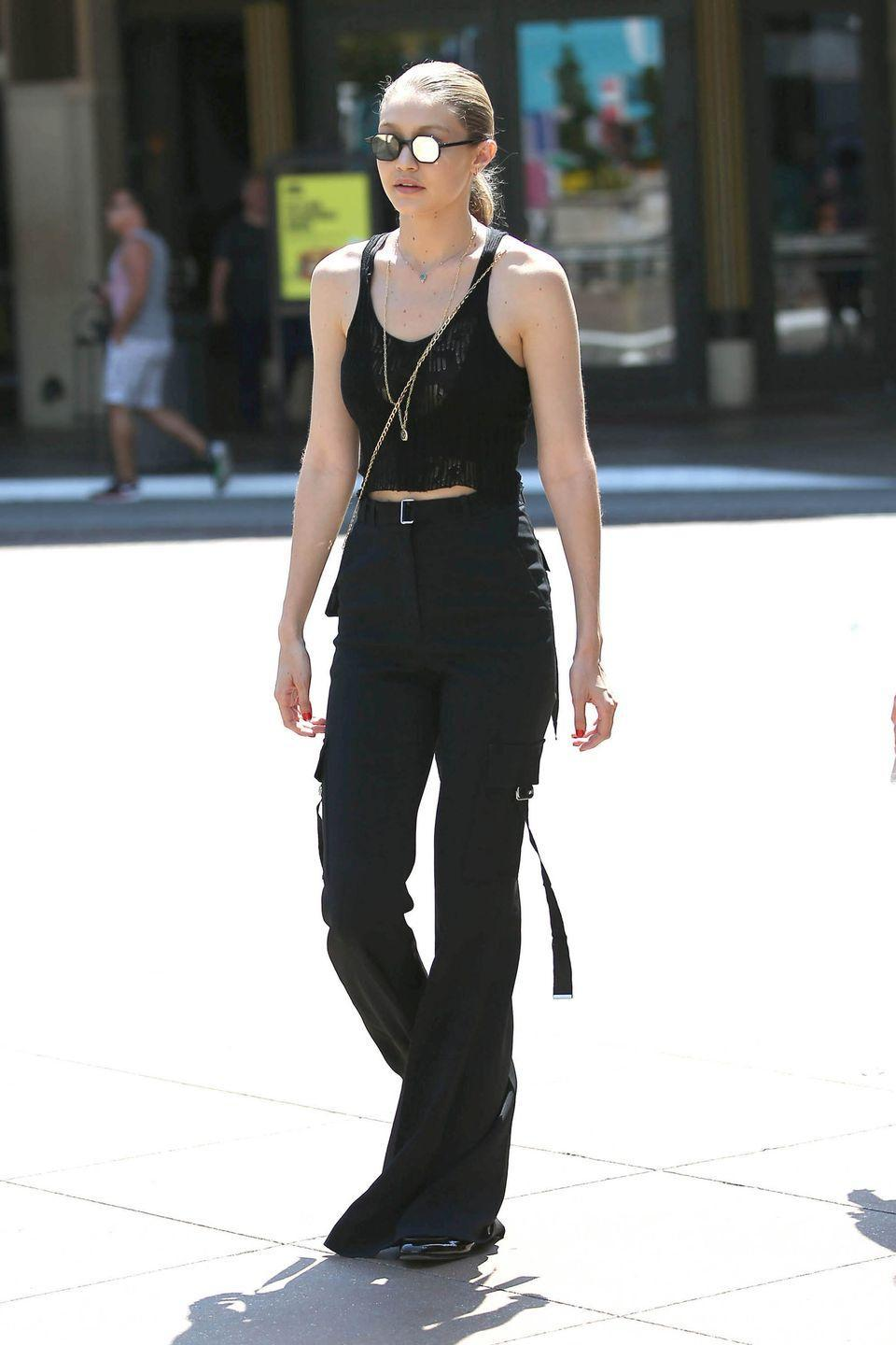 <p>In a mesh crop top, David Koma bellbottoms and Andy Wolf round-mirrored sunglasses while out in LA. </p>