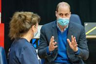 <p>Prince William talks with staff at a coronavirus vaccination center at Kings Lynn Corn Exchange on Monday in Kings Lynn, England. </p>