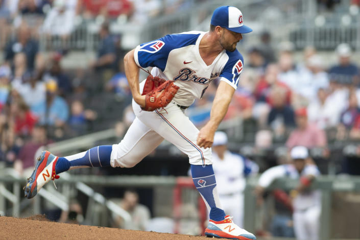 Atlanta Braves starting pitcher Kyle Muller throws against the Milwaukee Brewers during the first inning of a baseball game Saturday, July 31, 2021, in Atlanta. (AP Photo/Hakim Wright Sr.)
