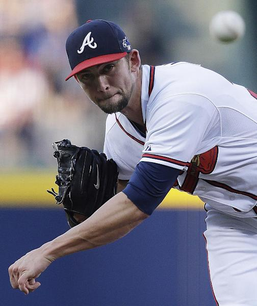 Atlanta Braves starting pitcher Mike Minor works against the Los Angeles Dodgers in the first inning of Game 2 of the National League division series, Friday, Oct. 4, 2013, in Atlanta. (AP Photo/Mike Zarrilli)