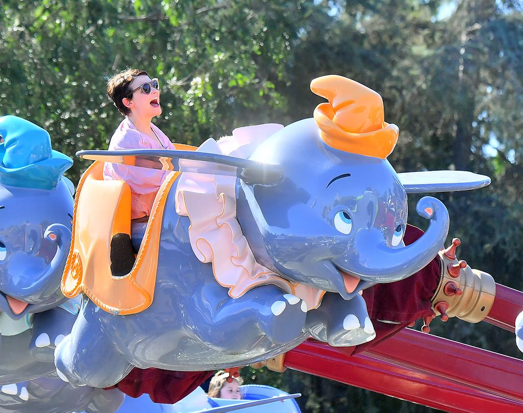 <p>The Disney actress had a ball on the Dumbo ride at the Happiest Place on Earth. We assume her sons with Josh Dallas, Oliver and Hugo, did too! (Photo: Fern Sharpshooter/Splash News) </p>