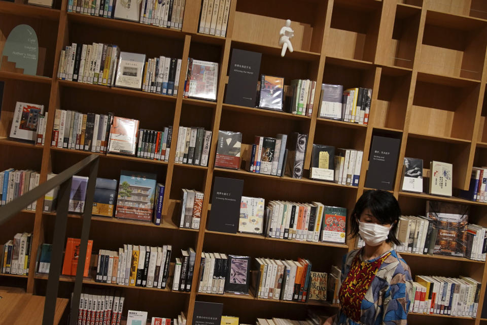 Books of Haruki Murakami are displayed at the university's new international house of literature as known as The Haruki Murakami Library at Waseda University Wednesday, Sept. 22, 2021 in Tokyo. The new literary center opening next month on the university campus is no ordinary kind. It's designed by renowned Japanese architect Kengo Kuma and featuring the world of Murakami and his works. (AP Photo/Eugene Hoshiko)