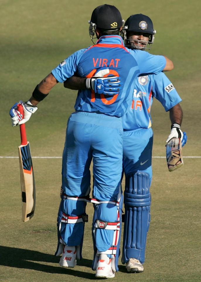 Indian captain Virat Kohli (L) is congratulated by his teammate Ambati Rayudu during the first match of the five match ODI cricket series between India and hosts Zimbabwe at the Harare Sports Club on July 24 2013. AFP PHOTO /Jekesai Njikizana.        (Photo credit should read JEKESAI NJIKIZANA/AFP/Getty Images)