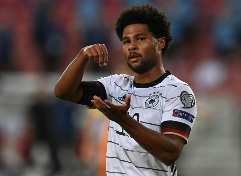 Germany winger Serge Gnabry celebrates with his stirring gesture after two goals in Sunday's 5-0 thrashing of Armenia (AFP/CHRISTOF STACHE)