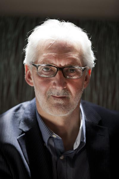 "British Cycling president Brian Cookson poses for photographs during a media briefing session in London, Tuesday, June 4, 2013. Cookson will challenge Pat McQuaid for the presidency of the International Cycling Union in a bid to restore the sport's reputation. Cookson, who had previously backed McQuaid's re-election bid, said in a statement provided by British Cycling that the ""widespread absence of confidence in the integrity of the organization"" led him to challenge the incumbent. (AP Photo/Matt Dunham)"