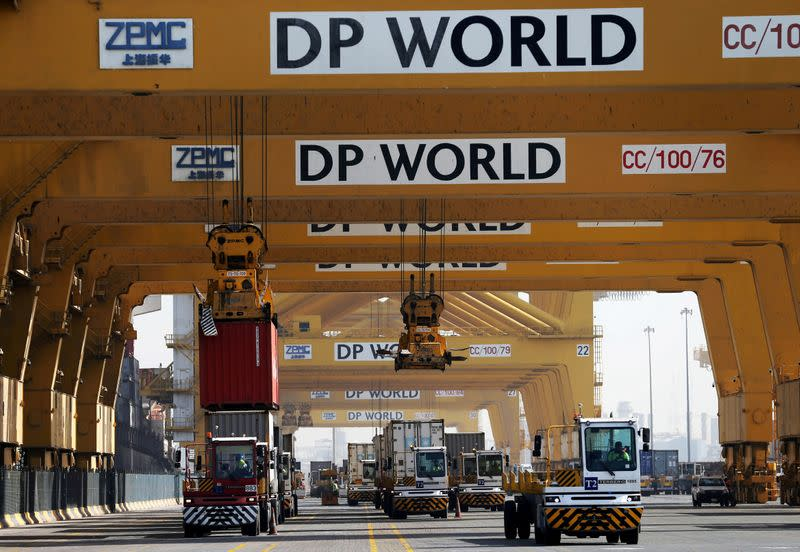 FILE PHOTO: Terminal tractors line up to load containers at DP World's Terminal 2 at Jebel Ali Port in Dubai