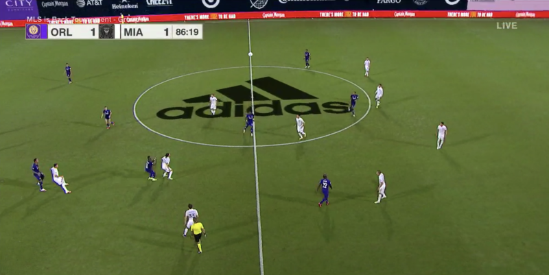 The first game of the MLS is Back Tournament had a giant Adidas logo superimposed in the center of the pitch on the ESPN broadcast. (Screenshot via ESPN)