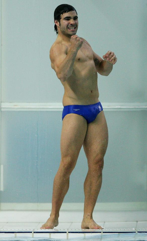BEIJING - AUGUST 19: Alexandre Despatie of Canada celebrates winning silver medal in the Men's 3m Springboard Fiinal at the National Aquatics Center on Day 11 of the Beijing 2008 Olympic Games on August 19, 2008 in Beijing, China. (Photo by Streeter Lecka/Getty Images)