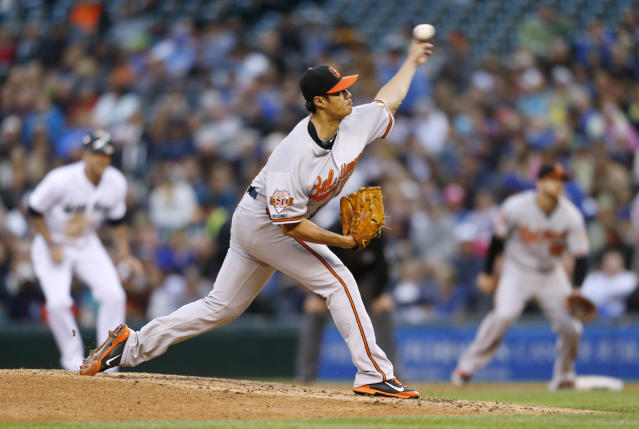 Baltimore Orioles' Wei-Yin Chen pitches to the Seattle Mariners during the fourth inning of a baseball game on Thursday, July 24, 2014, in Seattle. (AP Photo/John Froschauer)