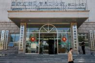 FILE PHOTO: A man walks past an office of the Cyberspace Administration of China (CAC) in Beijing