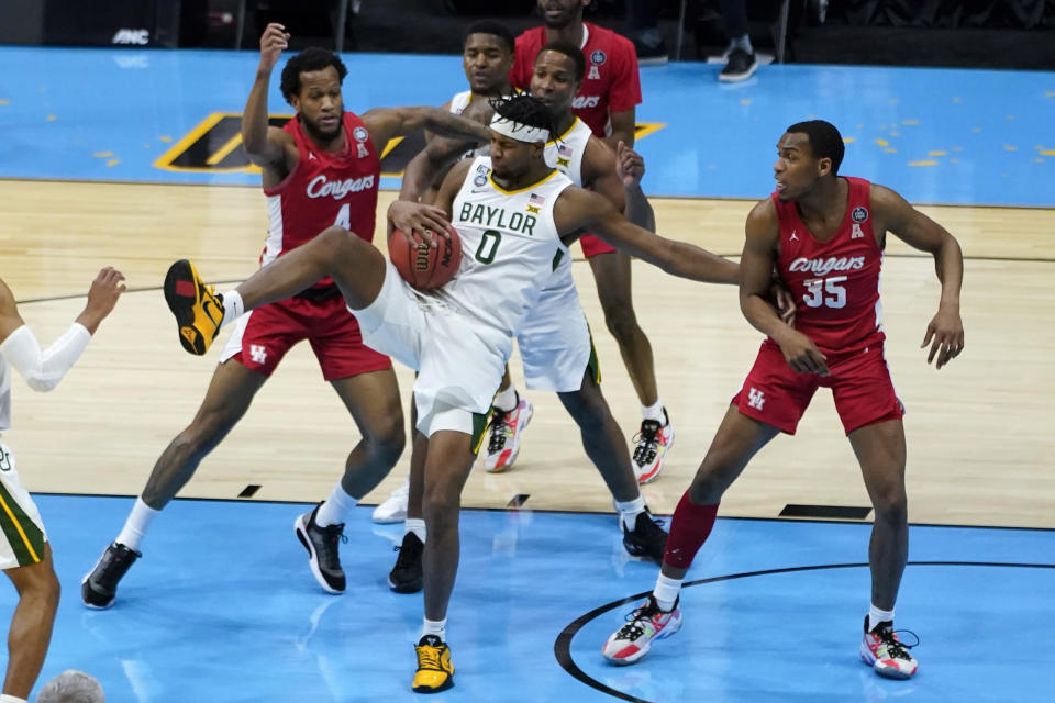 Baylor forward Flo Thamba (0) grabs a rebound between Houston forward Justin Gorham (4) and forward Fabian White Jr. (35) during the first half of a men's Final Four NCAA college basketball tournament semifinal game, Saturday, April 3, 2021, at Lucas Oil Stadium in Indianapolis. (AP Photo/Darron Cummings)
