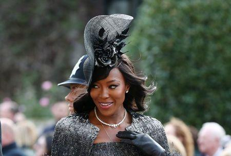 Naomi Campbell gives a look at the royal wedding.