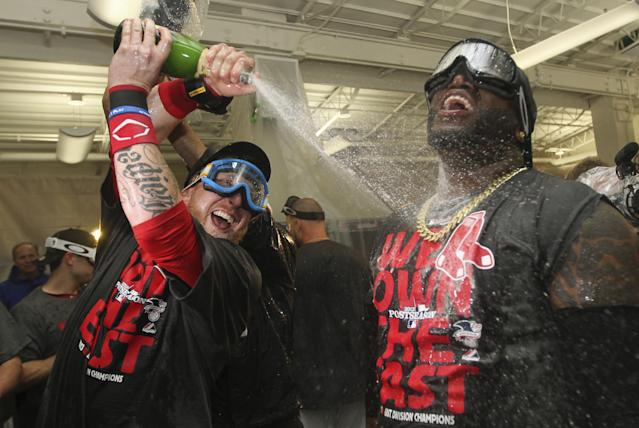 Boston Red Sox designated hitter David Ortiz, right, and teammate Mike Carp celebrate after the Red Sox clinched the AL East with a 6-3 win over the Toronto Blue Jays in a baseball game at Fenway Park, Friday, Sept. 20, 2013, in Boston. (AP Photo/Charles Krupa)