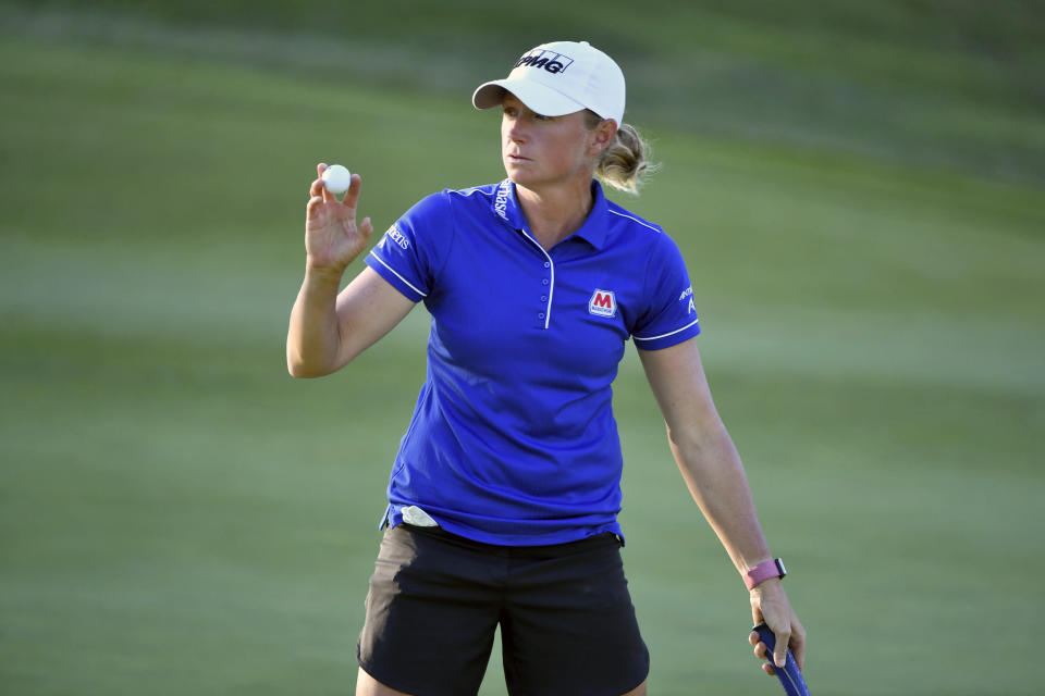 Stacy Lewis waves to fans after sinking her putt on the 9th green during the second round of the LPGA Walmart NW Arkansas Championship golf tournament, Saturday, Sept. 25, 2021, in Rogers, Ark. (AP Photo/Michael Woods)