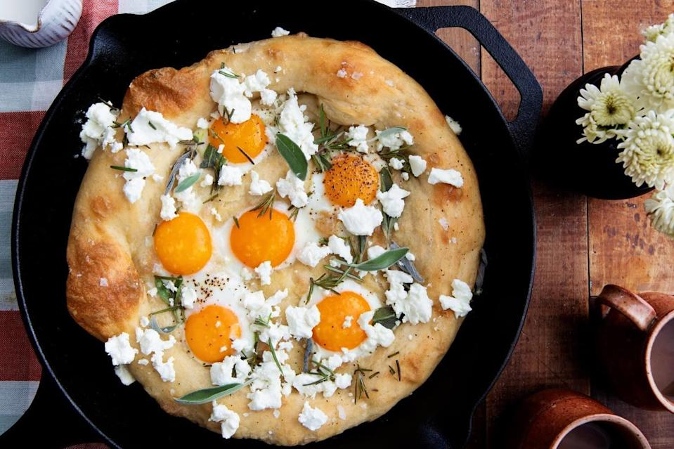 """<p>Goat cheese is tangy and creamy, which makes it a natural thing to pair with eggs and fresh herbs for this pizza, which is great for dinner or a <a href=""""https://www.thedailymeal.com/50-best-brunch-recipes?referrer=yahoo&category=beauty_food&include_utm=1&utm_medium=referral&utm_source=yahoo&utm_campaign=feed"""" rel=""""nofollow noopener"""" target=""""_blank"""" data-ylk=""""slk:midday brunch"""" class=""""link rapid-noclick-resp"""">midday brunch</a>.</p> <p><a href=""""https://www.thedailymeal.com/recipes/sunny-side-up-egg-pizza-goat-cheese-herbs?referrer=yahoo&category=beauty_food&include_utm=1&utm_medium=referral&utm_source=yahoo&utm_campaign=feed"""" rel=""""nofollow noopener"""" target=""""_blank"""" data-ylk=""""slk:For the Sunny Side Up Egg Pizza with Goat Cheese and Herbs recipe, click here."""" class=""""link rapid-noclick-resp"""">For the Sunny Side Up Egg Pizza with Goat Cheese and Herbs recipe, click here.</a></p>"""
