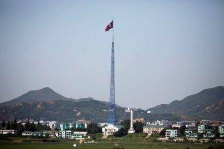 FILE PHOTO: A North Korean flag flutters on top of a tower at the propaganda village of Gijungdong in North Korea, in this picture taken near the truce village of Panmunjom, South Korea, August 26, 2017. REUTERS/Kim Hong-Ji/File Photo