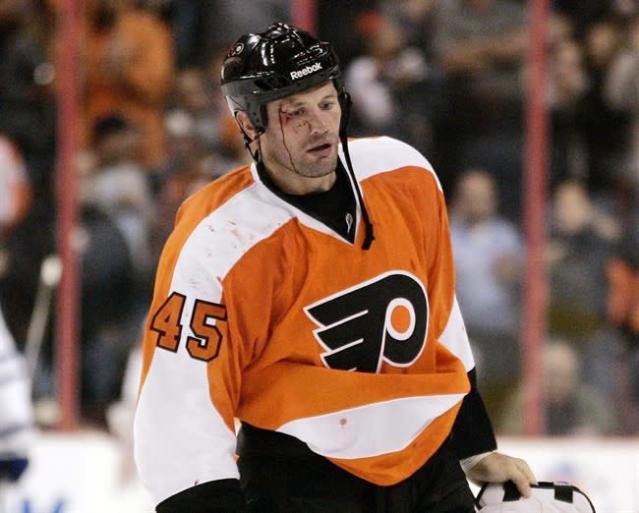 Philadelphia Flyers' Jody Shelley skates off the ice after a fight with Toronto Maple Leafs' Jay Rosehill in the second period of a preseason NHL hockey game, in Philadelphia on Sept. 21, 2011. As fighting is being phased out in the NHL and down the ranks of hockey, Shelley could be part of a dying breed of enforcers. THE CANADIAN PRESS/AP-Tom Mihalek, File