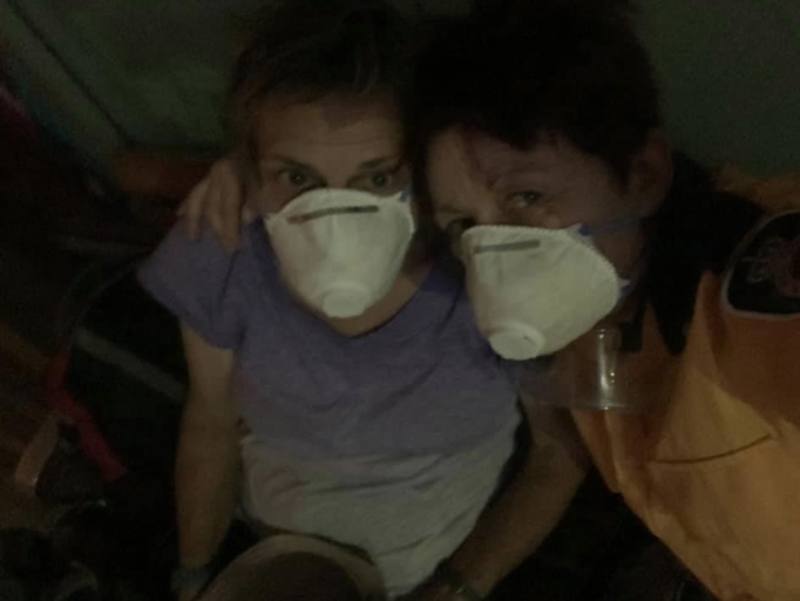 Rae Harvey and sanctuary volunteer Karen struggle to breathe in the thick smoke. Source: Supplied