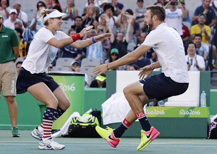 Bethanie Mattek-Sands, of the United States, left, runs into the arms of partner Jack Sock, after winning their mixed doubles gold medal match at the 2016 Summer Olympics in Rio de Janeiro, Brazil.