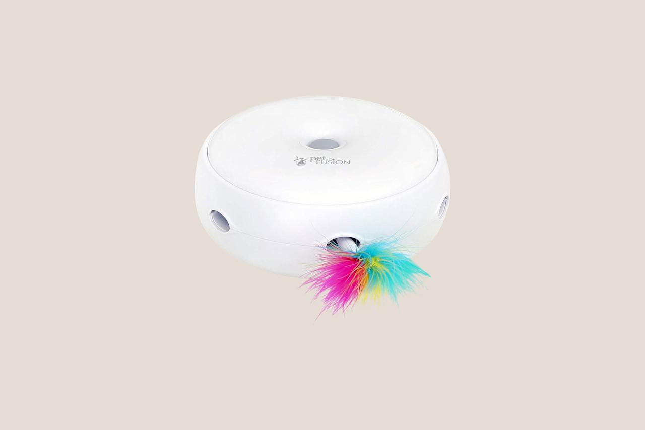 """<p>Simulated prey pops out from openings around the toy. Let your cat hone his hunting skills, day or night. The toy comes equipped with an LED light for nighttime play.</p> <p><em><strong>Shop Now: </strong>PetFusion Ambush Interactive Cat Toy with Electronic Rotating Feather, $26, <a href=""""https://pet-fusion.com/products/ambush-interactive"""">pet-fusion.com</a>.</em></p>"""