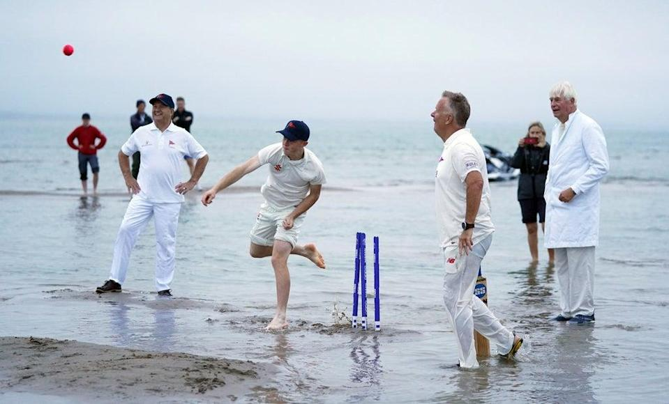 A bowler releases the ball after a soggy run-up (Andrew Matthews/PA) (PA Wire)