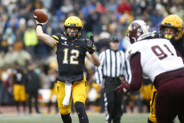 Appalachian State quarterback Zac Thomas (12) throws to an open receiver while getting pressure from Texas State defensive lineman Jordan Revels (91) during the first half of an NCAA college football game Saturday, Nov. 23, 2019, in Boone, N.C. (AP Photo/Brian Blanco)