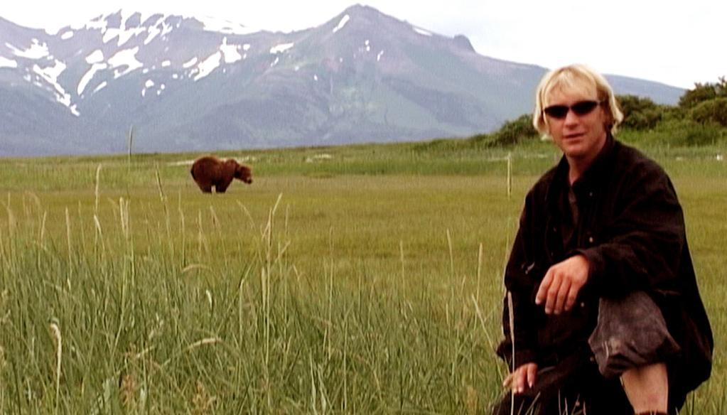 """<a href=""""http://movies.yahoo.com/movie/1808626954/info"""">Grizzly Man</a> (2005): And speaking of survival ... we know from the start of this documentary that Timothy Treadwell is doomed, but that doesn't make it any less riveting. Werner Herzog's film follows the events that led up to Treadwell's 2003 mauling by a bear in the Alaskan wild, a place this daring and charismatic man chose to call home for a dozen years to surround himself with these hulking creatures. He considered them his friends, shot video of himself frolicking with them, even gave them cutesy names. But as Herzog reveals, who Treadwell really was proved just as fascinating as his horrible fate."""