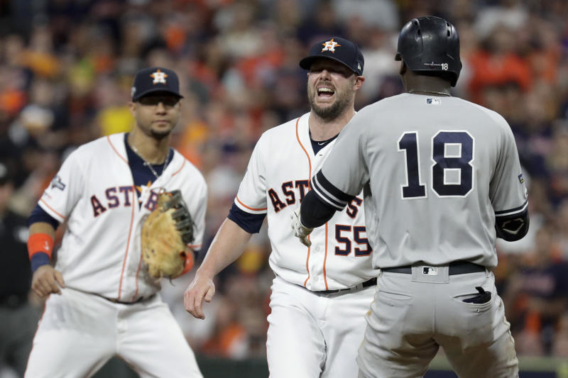 Houston Astros relief pitcher Ryan Pressly, (55), tags out New York Yankees' Didi Gregorius during the third inning in Game 6 of baseball's American League Championship Series Saturday, Oct. 19, 2019, in Houston. Pressly was injured on the play. (AP Photo/Eric Gay)