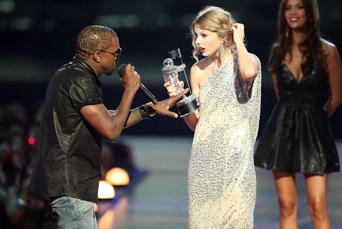 """<p><em>""""Yo Taylor, I'm really happy for you, and Imma let you finish, but Beyoncé had one of the best videos of all time … one of the best videos of all time!""""</em></p><p>That's what Kanye West said to Taylor Swift when he stormed the stage during her acceptance for Best Video by a Female Artist at the 2009 VMAs. It was the start of the <a href=""""https://www.vox.com/culture/2019/8/26/20828559/taylor-swift-kanye-west-2009-mtv-vmas-explained"""" rel=""""nofollow noopener"""" target=""""_blank"""" data-ylk=""""slk:Kanye vs. Taylor feud"""" class=""""link rapid-noclick-resp"""">Kanye vs. Taylor feud</a>, sure, but also one of the first moments we all collectively watched (in horror) on Twitter together. Live-tweeting events would never be the same.</p>"""
