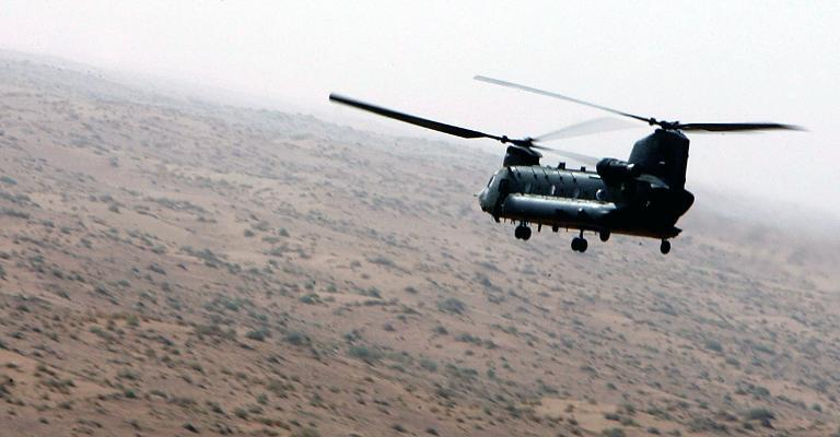A British Chinook helicopter flys over Helmand province, Afhganistan, in 2006
