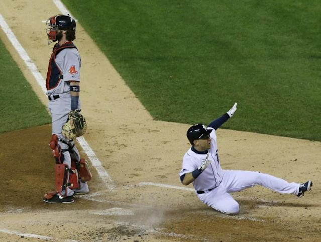 Detroit Tigers' Jose Iglesias reacts as he scores on a double by Torii Hunter in the second inning during Game 4 of the American League baseball championship series against the Boston Red Sox, Wednesday, Oct. 16, 2013, in Detroit. The Tigers won 7-3. (AP Photo/Paul Sancya)