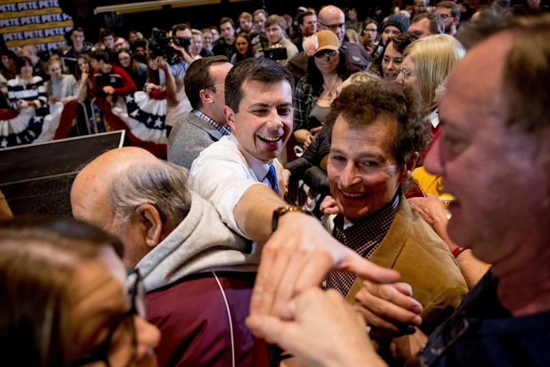 Democratic presidential candidate Pete Buttigieg (center) greets members of the audience during a campaign stop at Iowa State University on Jan. 13, 2020, in Ames, Iowa. (Photo: Andrew Harnik/ASSOCIATED PRESS)