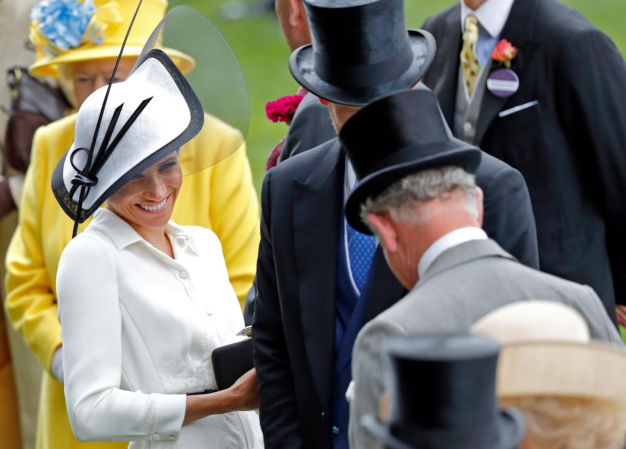 <p>Meghan looked thrilled to see her father-in-law at the Royal Ascot in June 2018.</p>