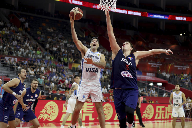 Argentina's Luis Scola tries to score past Serbia's Nikola Jokic during a quarterfinal match for the FIBA Basketball World Cup in Dongguan in southern China's Guangdong province on Tuesday, Sept. 10, 2019. Argentina beats Serbia 97-87. (AP Photo/Ng Han Guan)