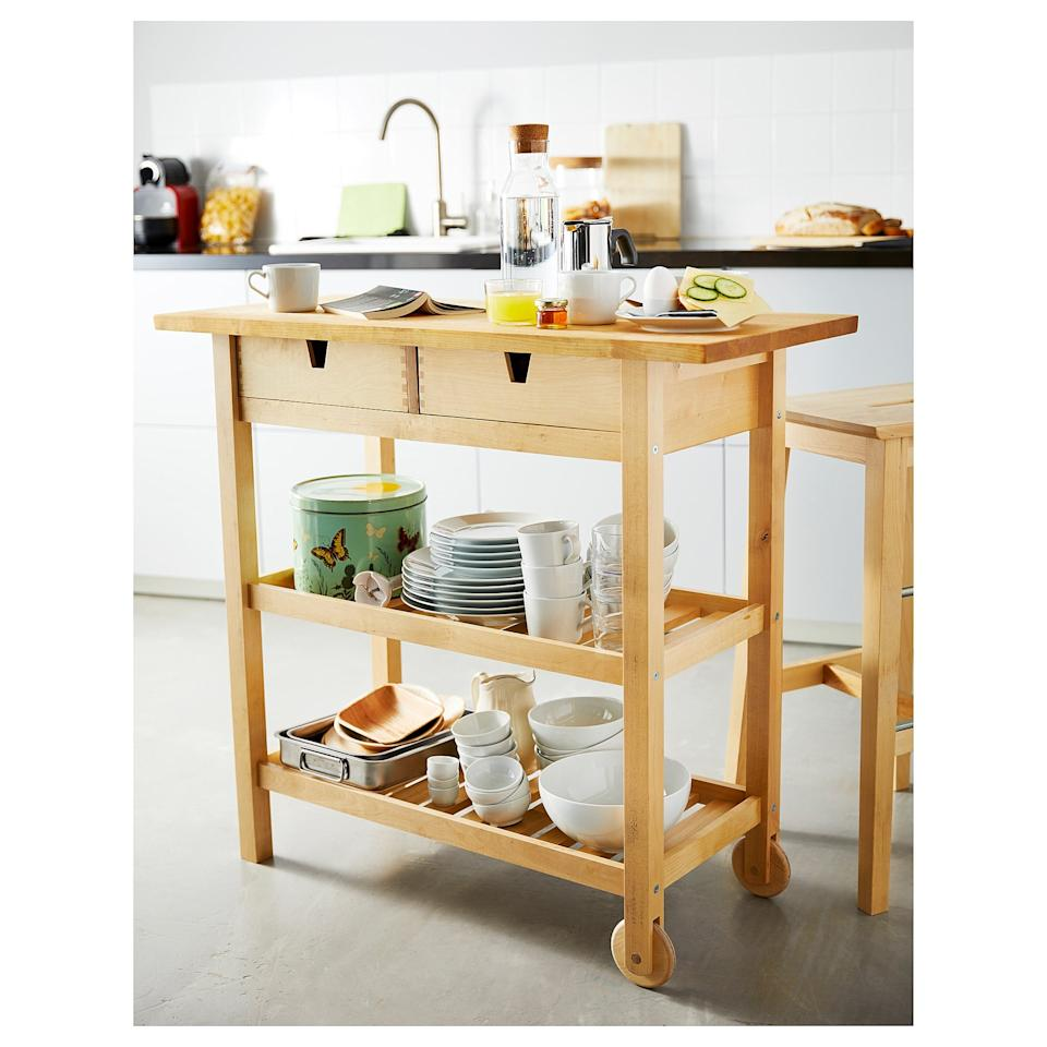 """<p>With two shelves and two drawers, this <a href=""""https://www.popsugar.com/buy/F%C3%B6rh%C3%B6ja-Kitchen-Cart-446999?p_name=F%C3%B6rh%C3%B6ja%20Kitchen%20Cart&retailer=ikea.com&pid=446999&price=109&evar1=casa%3Aus&evar9=46441488&evar98=https%3A%2F%2Fwww.popsugar.com%2Fphoto-gallery%2F46441488%2Fimage%2F46441779%2FF%C3%B6rh%C3%B6ja-Kitchen-Cart&list1=shopping%2Cfurniture%2Cikea%2Ckitchens&prop13=api&pdata=1"""" rel=""""nofollow"""" data-shoppable-link=""""1"""" target=""""_blank"""" class=""""ga-track"""" data-ga-category=""""Related"""" data-ga-label=""""https://www.ikea.com/us/en/catalog/products/80035920/"""" data-ga-action=""""In-Line Links"""">Förhöja Kitchen Cart</a> ($109) can hold everything from seasonal baking essentials to everyday kitchen necessities.</p>"""
