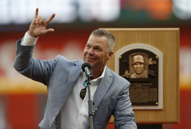 Former Atlanta Braves third baseman and Baseball Hall of Fame member Chipper Jones waves to the crowd as he speaks during a ceremony before a baseball game against the Milwaukee Brewers, Friday, Aug. 10, 2018, in Atlanta. (AP Photo/John Bazemore)