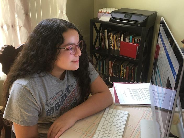 Isabela Hernandez works on a school assignment from home in Gilbert, Ariz.