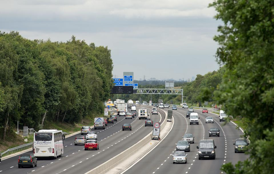 """Vehicles on the new13.4-mile long M3 """"smart"""" motorway near Longcross, Surrey, between Farnborough and the M25."""