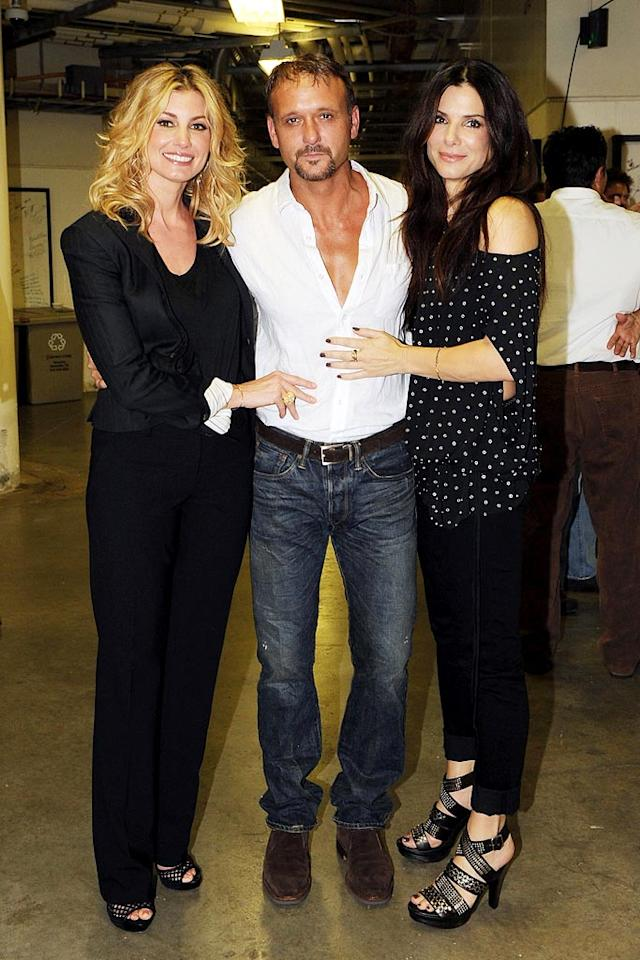"Sandra Bullock posed backstage with her ""Blind Side"" co-star Tim McGraw and his wife Faith Hill at Nashville Rising: A Benefit Concert for Flood Recovery on Tuesday night. Rick Diamond/Nashville Rising/<a href=""http://www.gettyimages.com/"" target=""new"">GettyImages.com</a> - June 22, 2010"