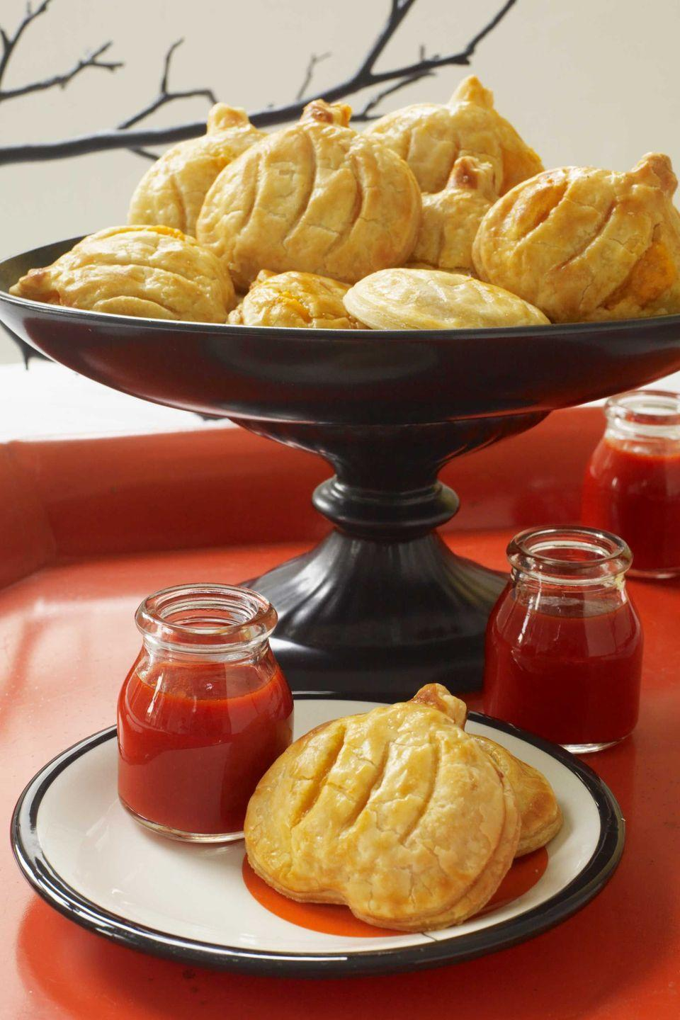 """<p>These snacks are ideal for any autumn-themed gathering, as they don't take much effort to make, so you can get them on the table in a flash.</p><p><strong><em><a href=""""https://www.womansday.com/food-recipes/food-drinks/recipes/a10925/pumpkin-patch-bites-recipe-122164/"""" rel=""""nofollow noopener"""" target=""""_blank"""" data-ylk=""""slk:Get the Pumpkin Patch Bites recipe."""" class=""""link rapid-noclick-resp"""">Get the Pumpkin Patch Bites recipe. </a></em></strong> </p>"""