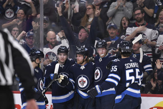 Winnipeg Jets' Nikolaj Ehlers, middle, celebrates his goal against the Los Angeles Kings with Ville Heinola (14), Patrik Laine (29) and Mark Scheifele (55) during the second period of an NHL hockey game Tuesday, Oct. 22, 2019, in Winnipeg, Manitoba. (Fred Greenslade/The Canadian Press via AP)