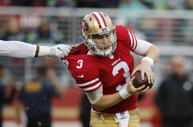 <p>San Francisco 49ers quarterback C.J. Beathard has his jersey pulled as he tries to throw against the Seattle Seahawks during the first half of an NFL football game Sunday, Nov. 26, 2017, in Santa Clara, Calif. (AP Photo/John Hefti) </p>
