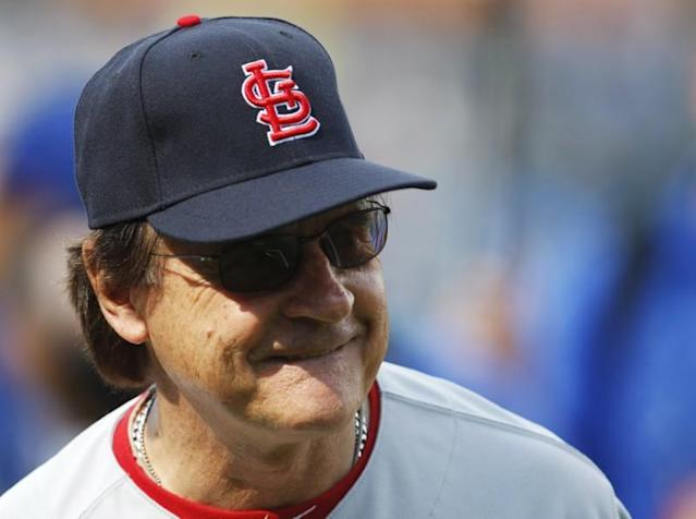 National League All-Star manager Tony La Russa of the St. Louis Cardinals laughs before Major League Baseball's All-Star Game in Kansas City
