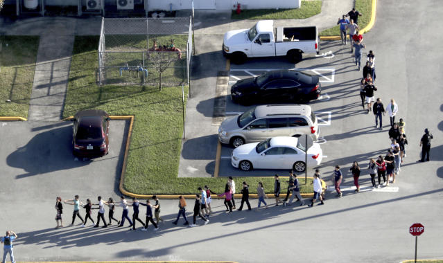 Police evacuate students at Marjory Stoneman Douglas High School in Parkland, Fla., on Wednesday. (Photo: Mike Stocker/ South Florida Sun-Sentinel)